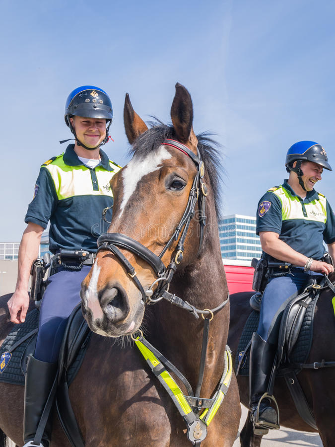 Dutch mounted police. ALMERE, NETHERLANDS - 12 APRIL 2014: Dutch mounted police showing their skills at the first National Security Day held in the city of stock photo