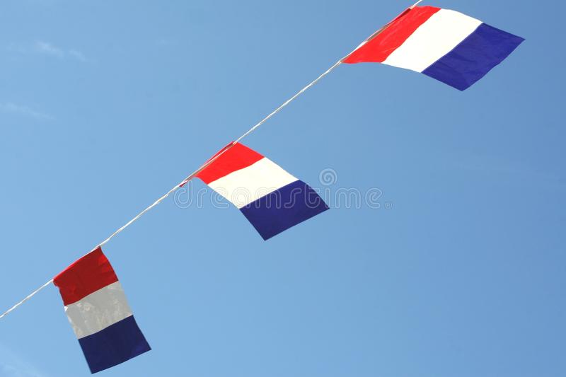 National Dutch flags of the Netherlands in a blue sky. Dutch national flags for Koningsdag (Kingsday), Liberation Day and the European and World Cup football stock image