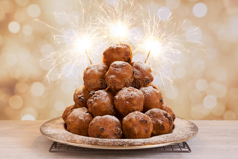 Dutch New Year's Eve with oliebollen, a traditional pastry royalty free stock images