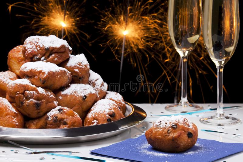 Dutch New Year`s Eve with oliebollen, a traditional pastry royalty free stock image