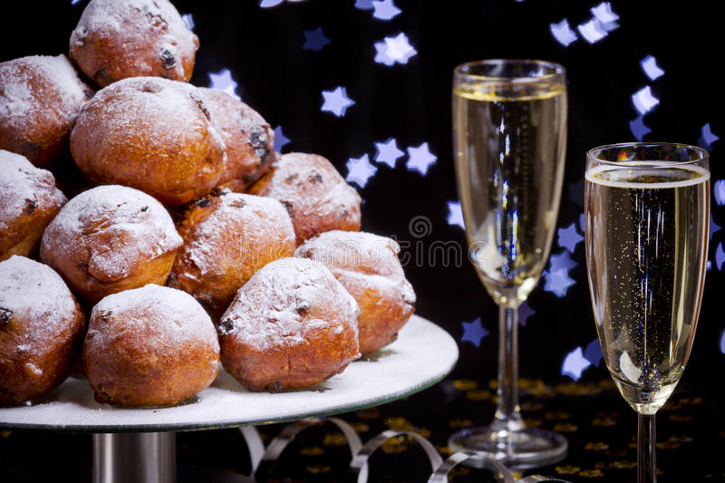 Dutch New Year's Eve with oliebollen, a traditional pastry royalty free stock photos