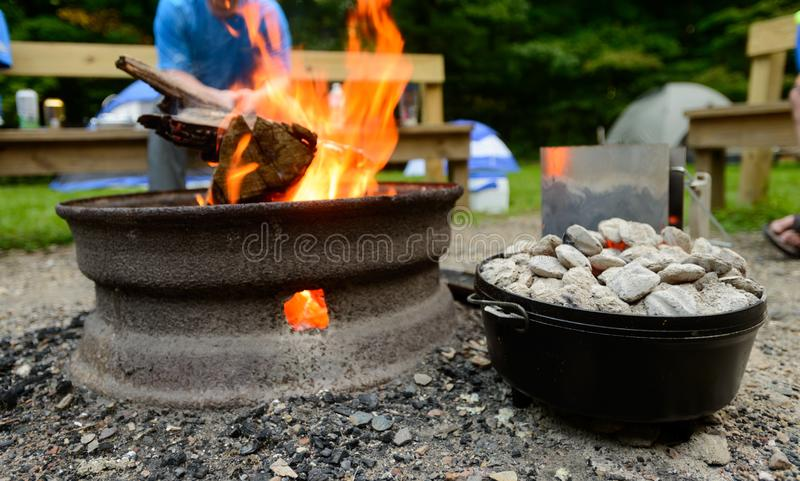 Dutch oven cooking at campsite stock images