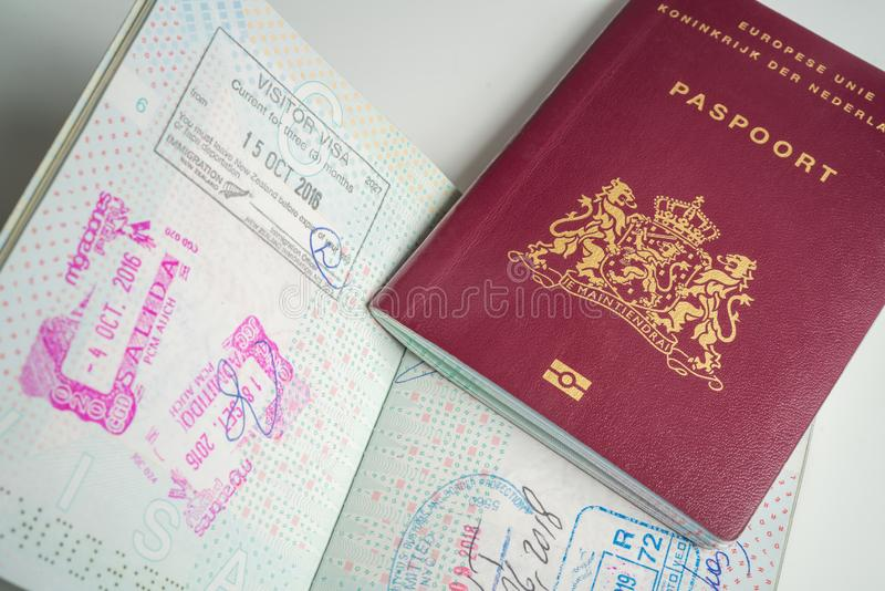 Dutch passport with stamps. From diferent countrys like New Zealand, Peru, and USA New York, abroad, airport, border, citizenship, control, customs, document stock photo