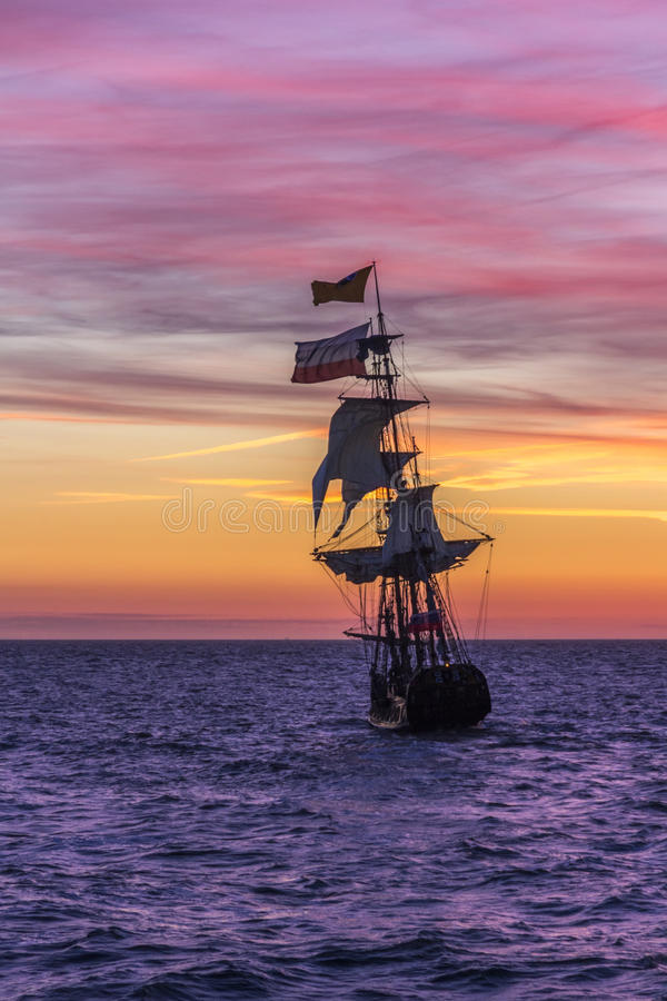 Dutch Pirate Ship. Pirate Ship leaving the harbor at the sunset for a long campaign against the loyal marines stock photos