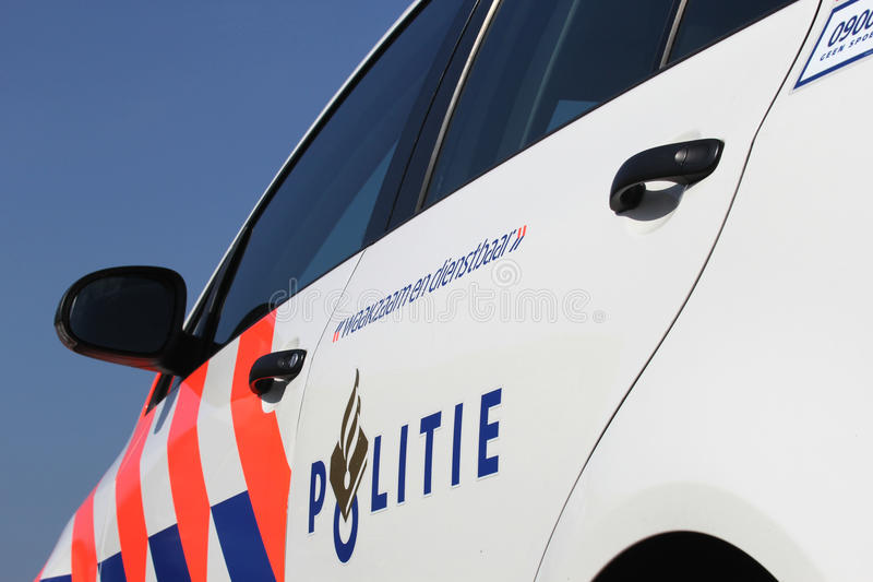 Dutch police car. Side door of a Dutch police car stock images