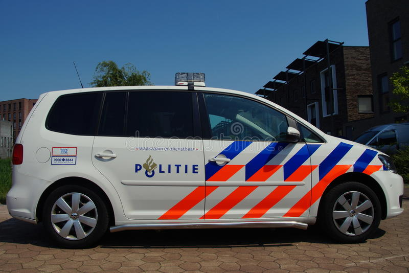 Dutch Police Car (Volkswagen Touran) - Nationale politie. Almere Poort, Flevoland, The Netherlands - June 5, 2015: Dutch National Police Car , Volkswagen Touran royalty free stock image
