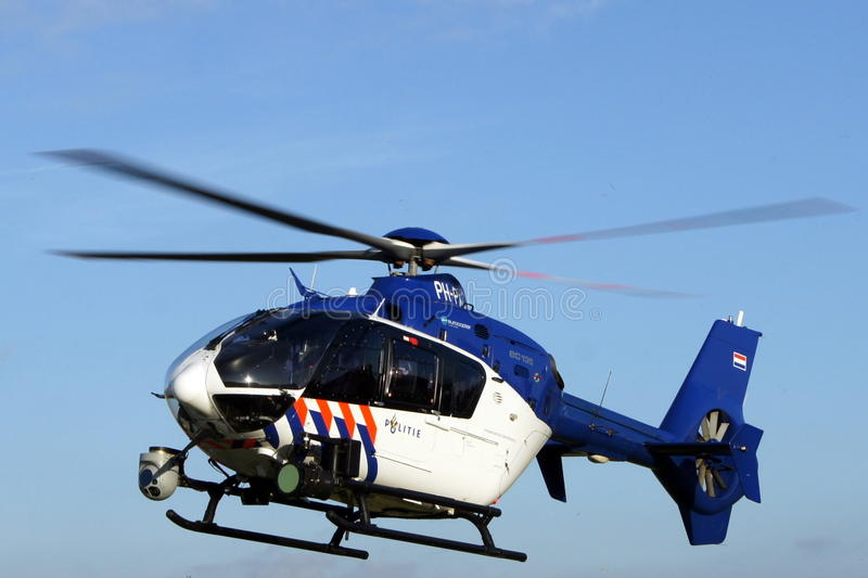 Dutch police helicopter in flight - Euro Copter. Almere, The Netherlands - September 2, 2013: Dutch police helicopter flies over stock photography