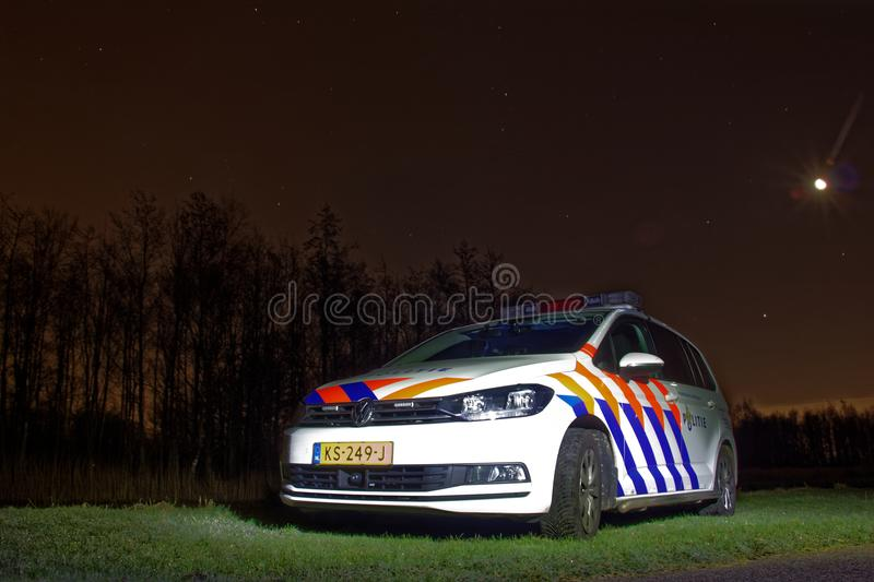 Dutch policecar at night stock image