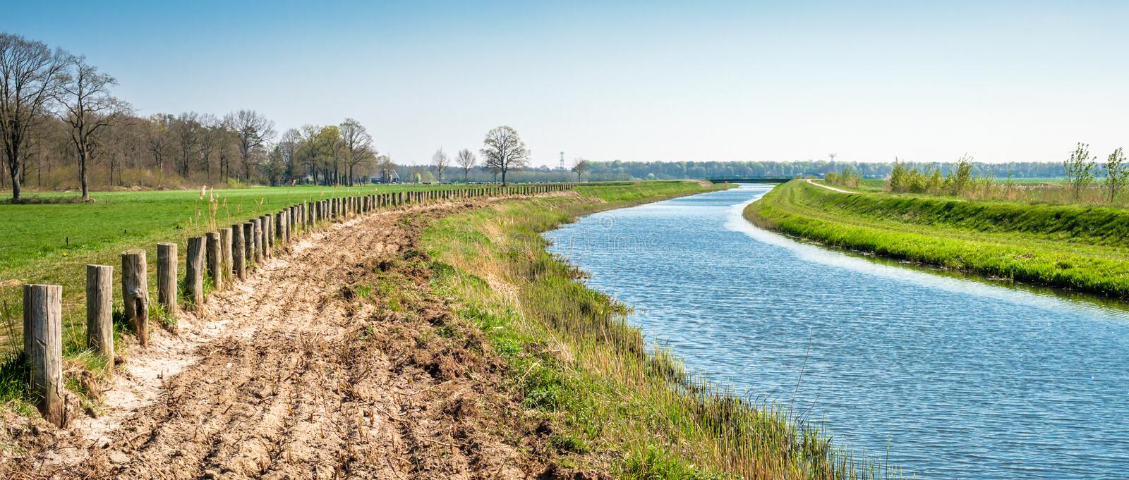 Dutch river and farm landscape near Markelo Twente, Overijssel, Netherlands. When walking the Dutch Hiking Tour of the Year near the village of Markelo royalty free stock photos