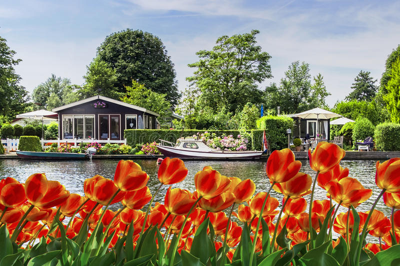 Dutch river side cottage royalty free stock image
