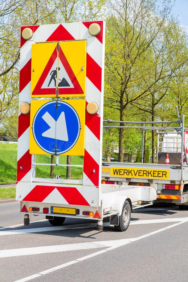 Dutch road works with truck and traffic signs. Road works with truck and traffic signs in the Netherlands royalty free stock images