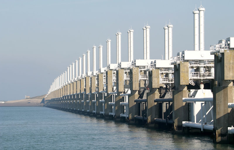 A dutch storm surge barrier. The Oosterschelde storm surge barrier is part of the Delta Works in the Netherlands. It is an open barrier, which could be closed to royalty free stock photos