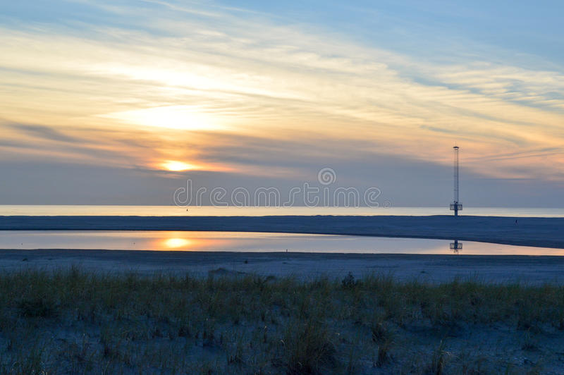 Dutch summer sunset. In The Netherlands. Zandmotor Den Haag stock photos