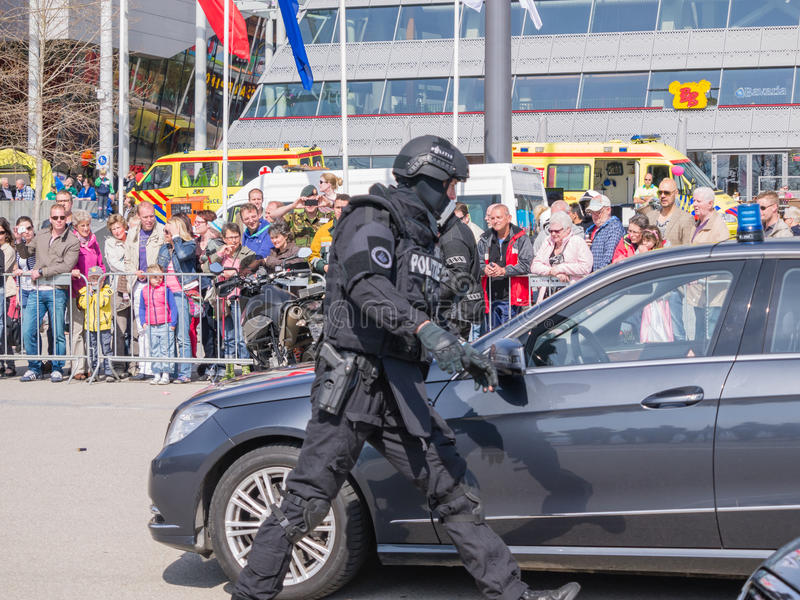Dutch SWAT team in action. ALMERE, NETHERLANDS - 12 APRIL 2014: SWAT team during a demonstration of an enacted robbery during the first National Security Day royalty free stock photography