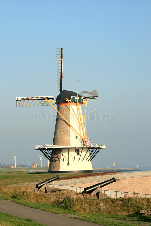 Download Dutch Tower Mill And Cannons Stock Photos - Image: 4789233