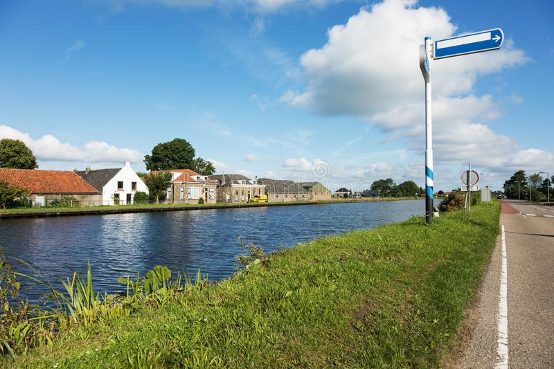 Dutch typical houses by the river bank royalty free stock photo