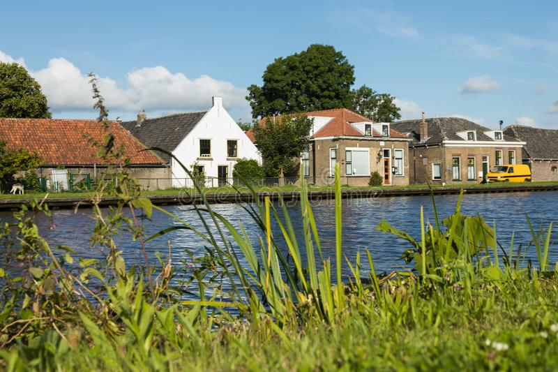 Dutch typical houses by the river bank stock photos