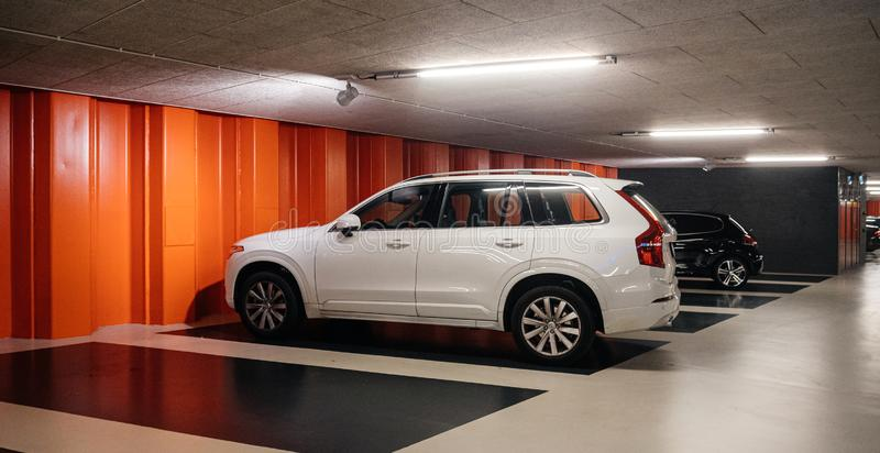 Dutch underground parking with luxury SUV stock photography