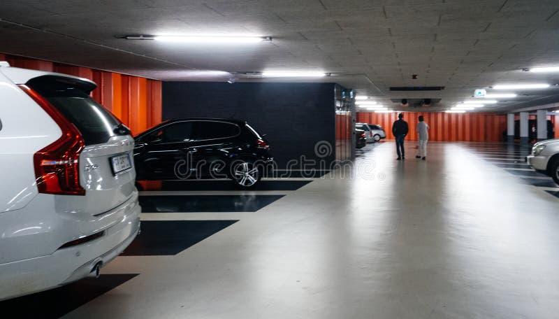 Dutch underground parking with luxury white Volvo XC90 stock images