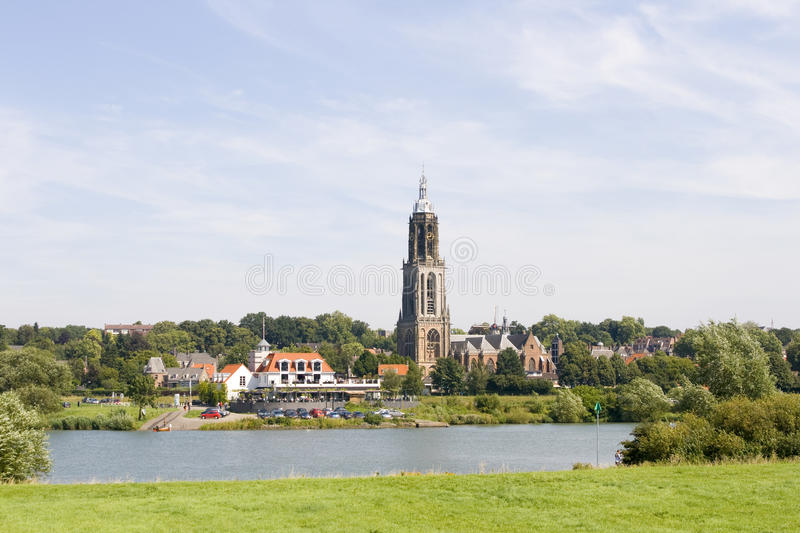 Download Dutch Village With Church On Riverfront Stock Image - Image: 10772641