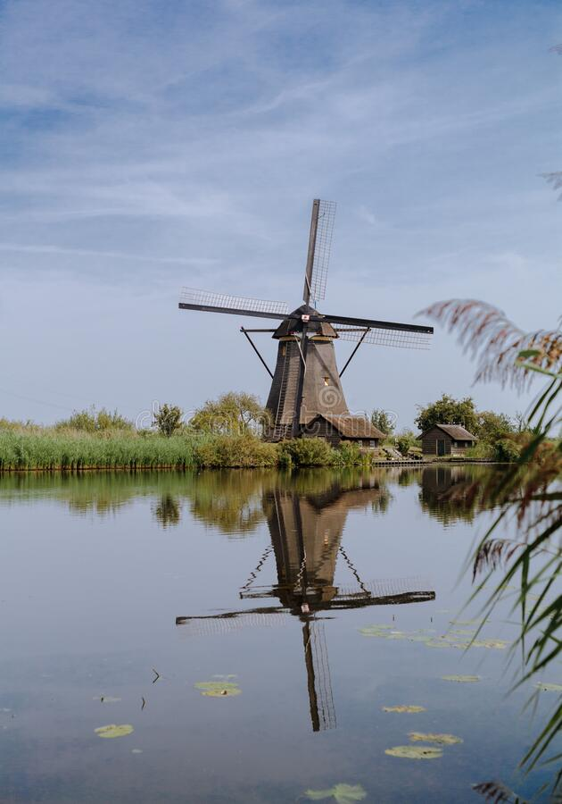 Dutch windmill alongside the canal royalty free stock photos