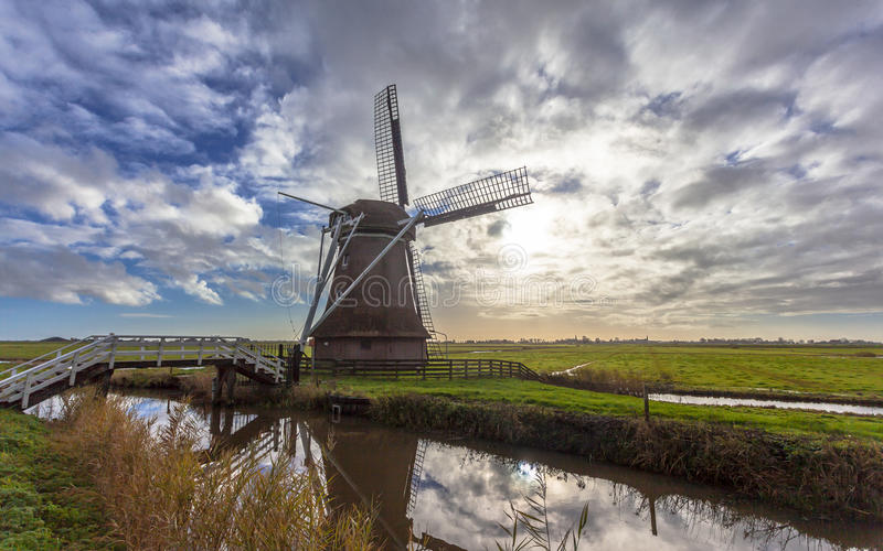 Dutch windmill in frisian polder royalty free stock photo