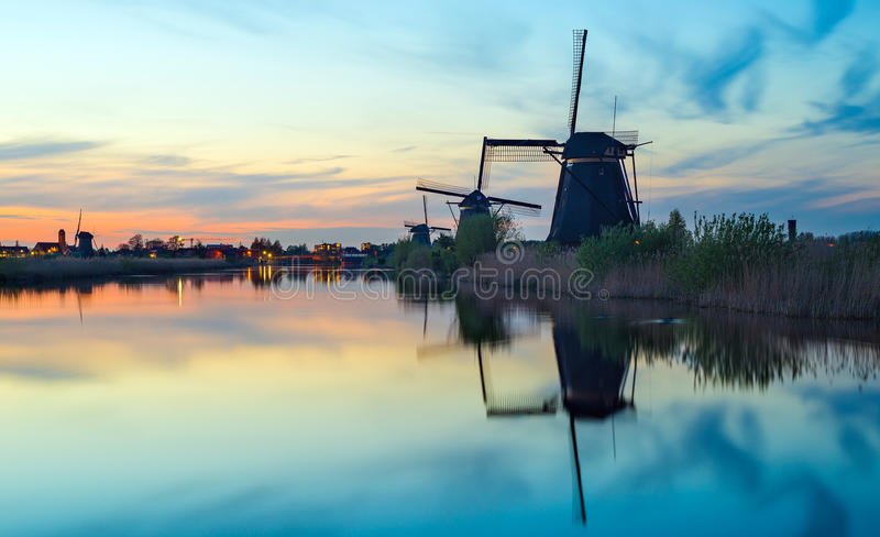 Dutch windmills. Sunset with the dutch windmills at Kinderdijk, an UNESCO world heritage site royalty free stock images