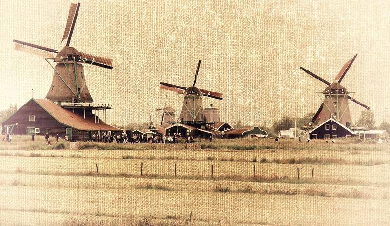 Dutch windmills. Traditional Dutch windmills in the style of old photography. Zaanse Schans. Holland stock image