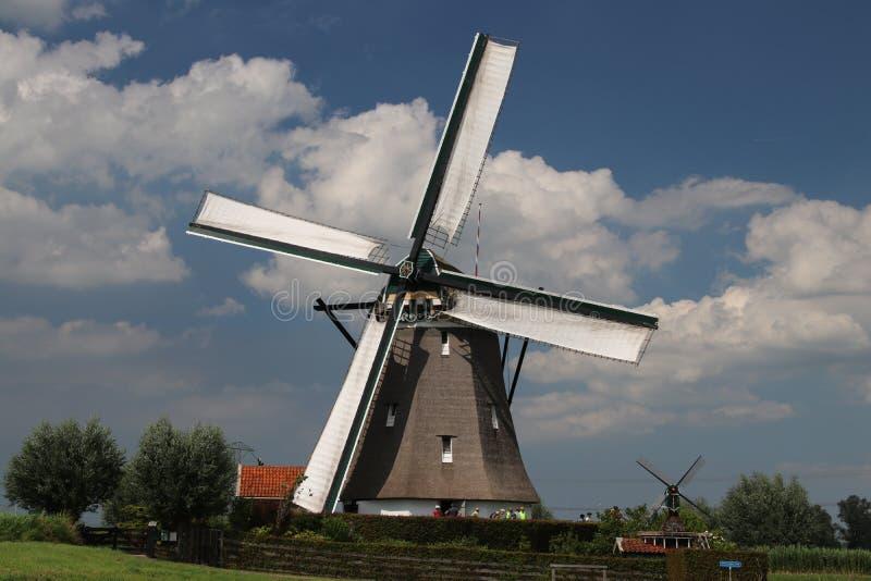 Dutch windmills in the tweemanspolder to keep the water out of the polder. Dutch windmills in the tweemanspolder to keep the water out of the polder stock photos
