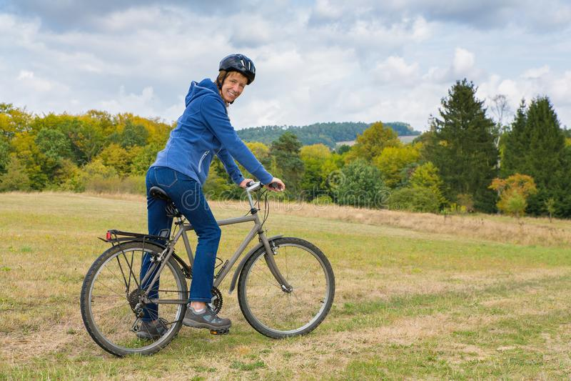 Dutch woman on mountain bike in nature royalty free stock photo