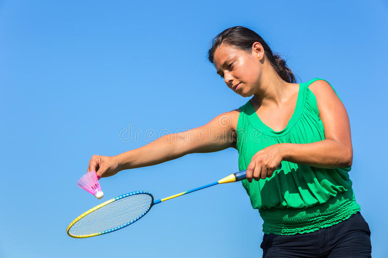 Dutch woman serve with badminton racket and shuttle stock photography