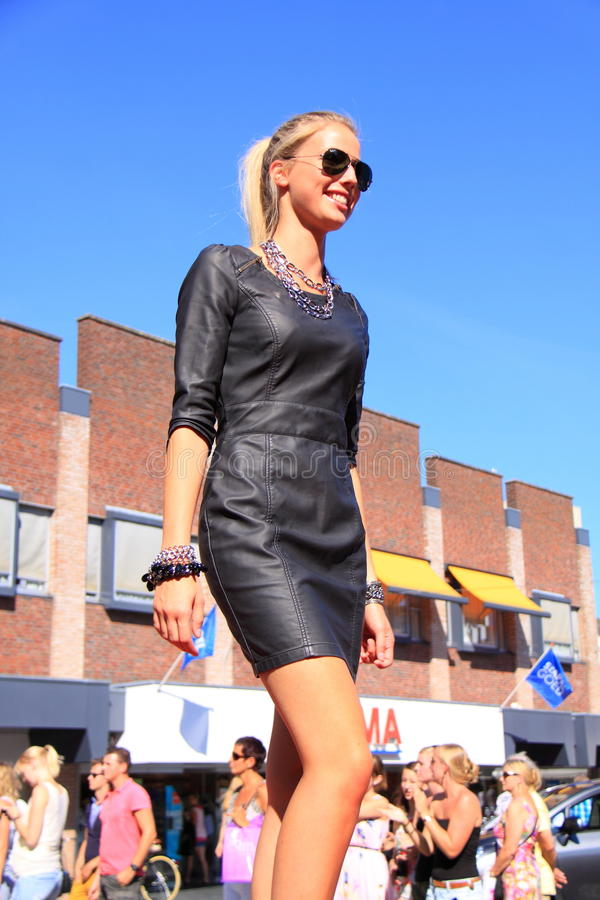 Dutch woman street fashion leather dress royalty free stock image