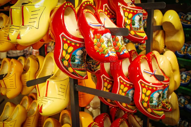 Dutch wooden shoes in the souvenir shop. Red and yellow Clog and royalty free stock photos