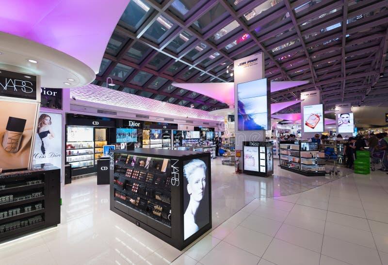 Duty free cosmetics shopping, Bangkok airport stock photo