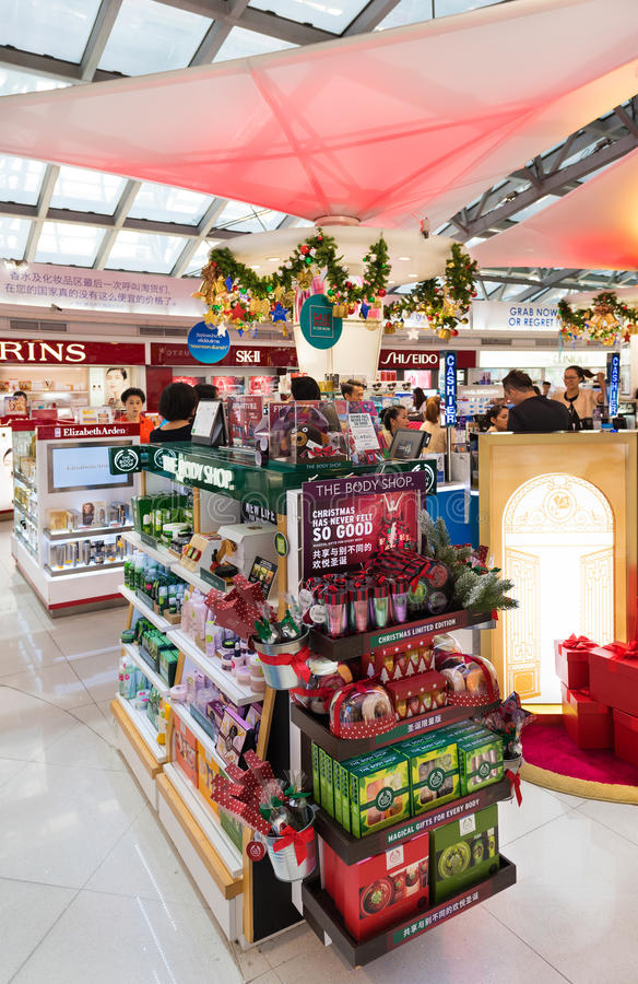 duty free cosmetics shopping before Christmas, airport of Bangkok royalty free stock photo