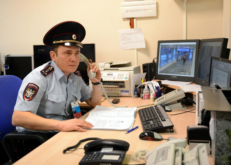 The duty of the police of the airport Sheremetyevo. MOSCOW, RUSSIA - DECEMBER 13, 2013: The duty of the police of the airport Sheremetyevo royalty free stock photo