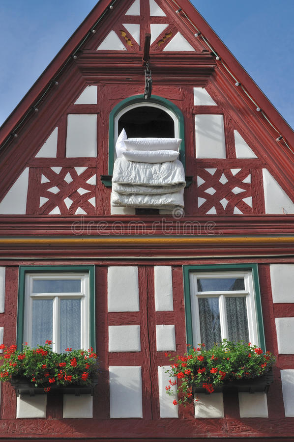 Duvet at window #1, bad wimpfen. Duvet exposed at a window of old wattle house in city center stock photography