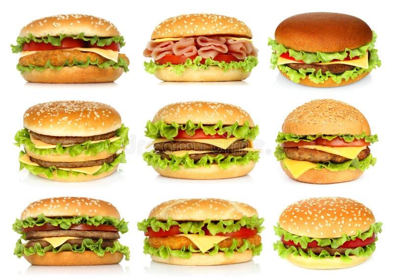 Duzi hamburgery ustawiający na białym tle obraz royalty free