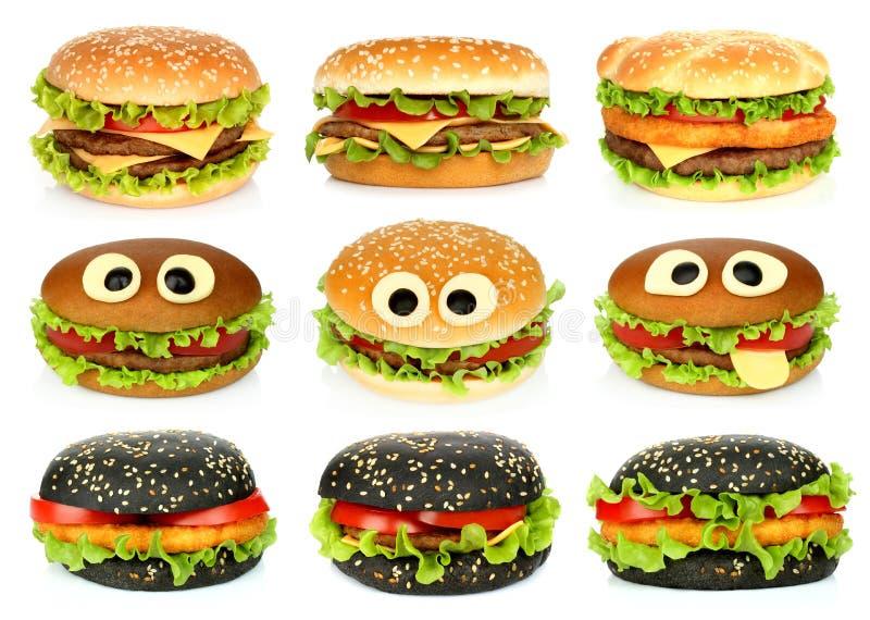 Duzi hamburgery ustawiający na białym tle zdjęcia stock