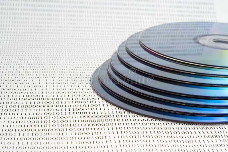 DVD. Disk on binary background royalty free stock image