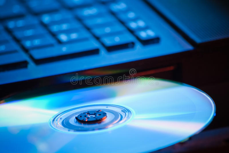 DVD in blue light royalty free stock image