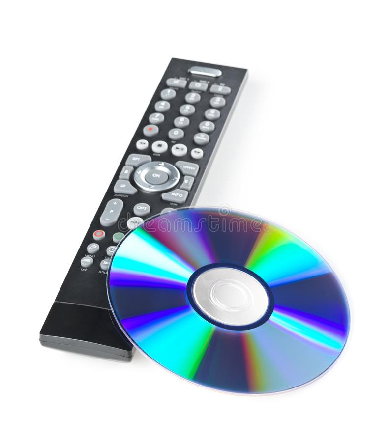 DVD, CD-ROM or Blu-Ray disc with tv or disc player remote control on white background. Home theatre movie or series concept.  royalty free stock photography