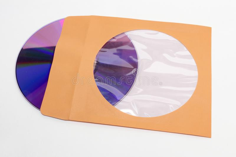 DVD compact disc sticking out of paper envelope. clipping path stock photo