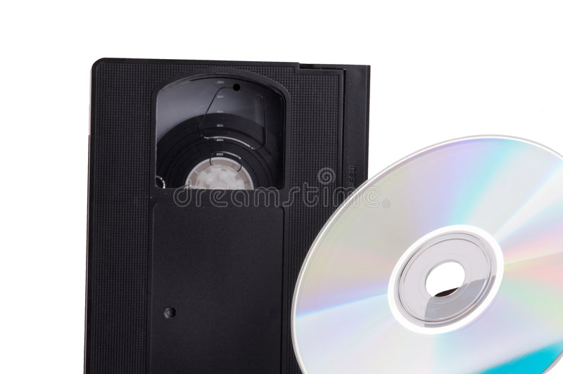 DVD contra Video Cassette. Abstract contrast of the evolution from video cassette to DVD - isolated on white background royalty free stock image