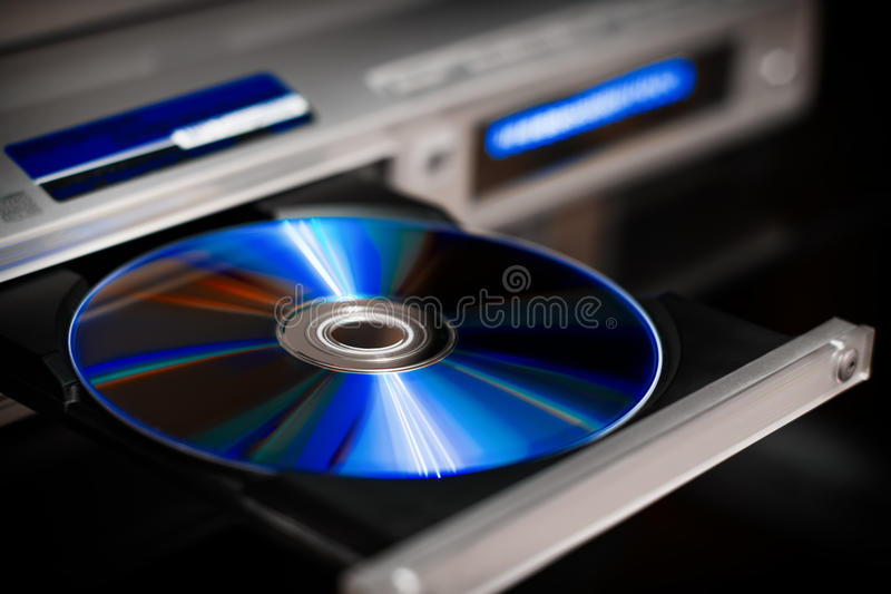 DVD disc eject. Optical CD and DVD discs with music and movies in plastic case royalty free stock photos