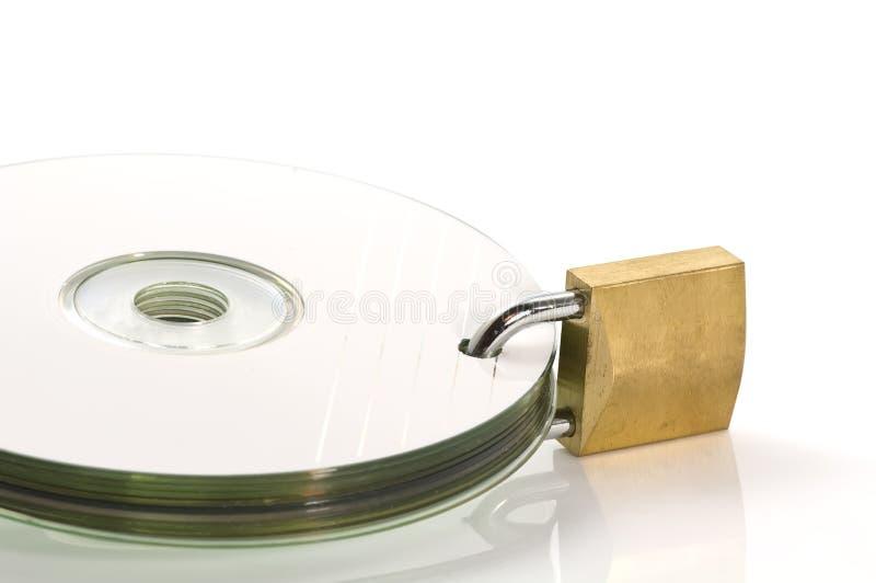 DVD discs and padlock stock photos