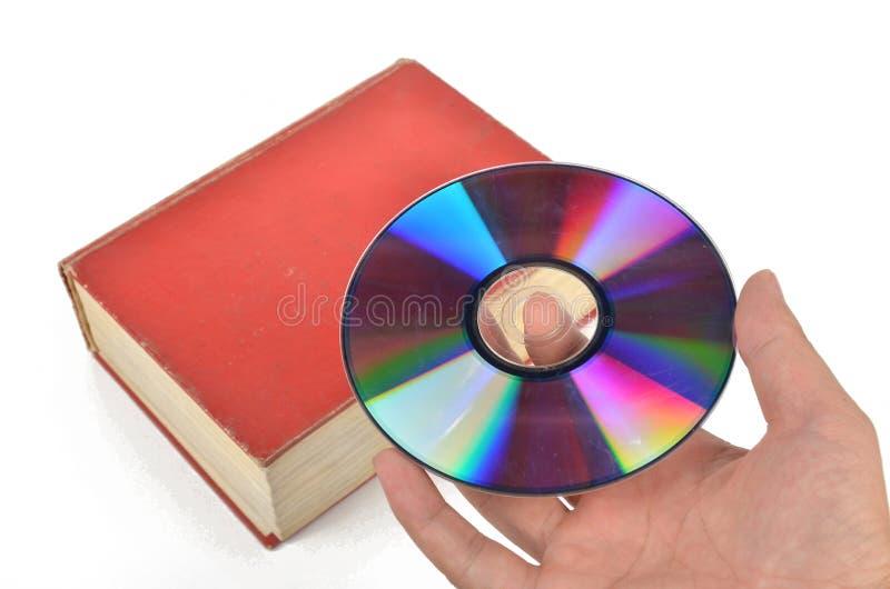 DVD e libro fotografie stock