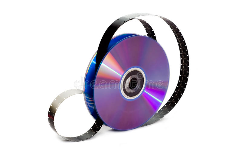 DVD and Film. Film reeled up between the disks, isolated on white background royalty free stock photo