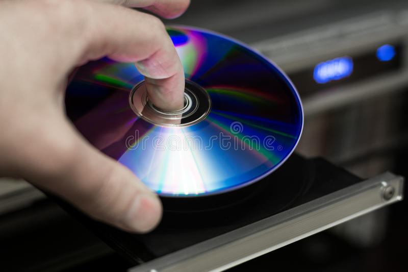 DVD player. DVD movie insert in optical disc player royalty free stock images