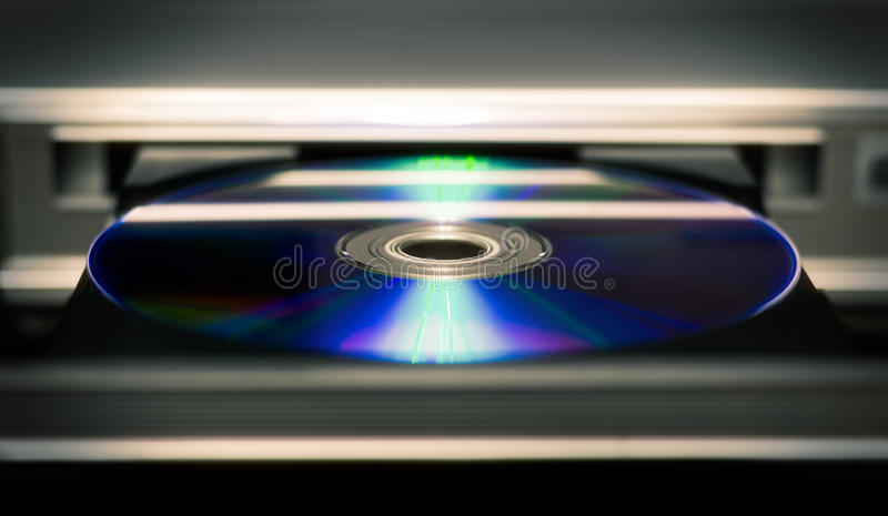 DVD player. Optical CD and DVD disc with music and movies stock image